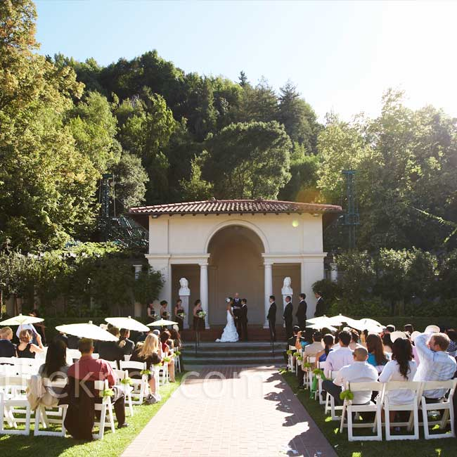 Chairs were set up on either side of the brick pathway aisle leading up to the gazebo-like structure where the couple said their vows.
