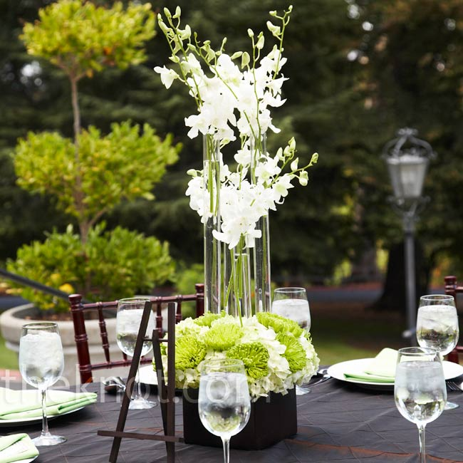 Tall acrylic tubes with stems of Hawaiian orchids were nestled into boxes of spider mums and hydrangeas for a modern, architectural look.