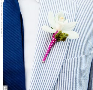 Each groomsman wore a single white orchid with berries wrapped in polka-dot ribbon on his lapel.