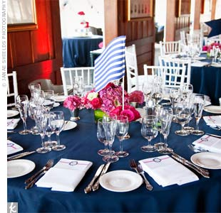 Navy-blue linens topped the round tables, and preppy yacht-flag table markers were set inside the centerpieces.