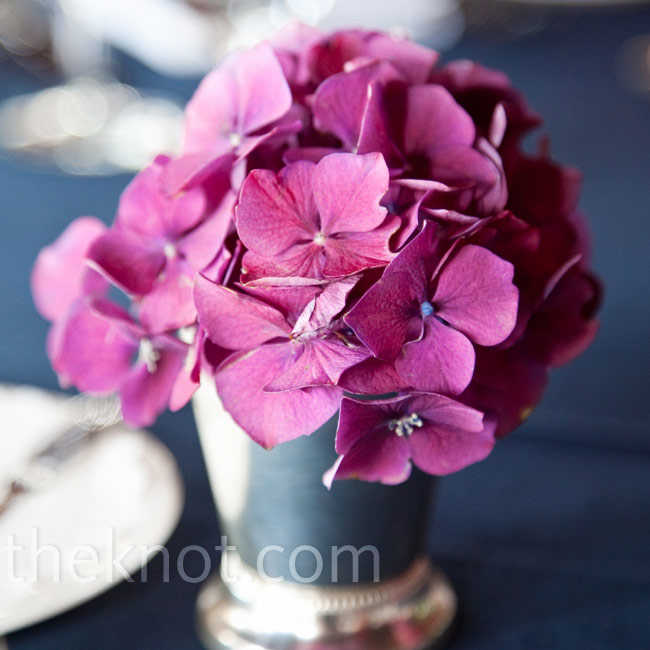 Instead of a single large arrangement, lots of small ones (like these pink hydrangeas) made up the table centerpieces.