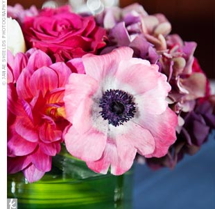 Low arrangements of pink flowers, like anemones, topped the tables.