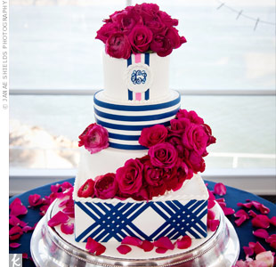 To go with their preppy theme, the couple's cake had lots of navy stripes. Fuchsia ranunculus and roses added extra color.