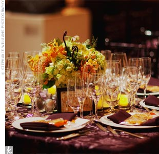 The couple opted for deep-plum table linens to pop against the venue's white and gray marble. Square tables fit well between the room's sculptures.