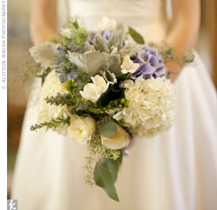Courtney carried a lush bouquet of hydrangeas, silver leaf and lambs ears accented with herbs like mint, sage and thyme.