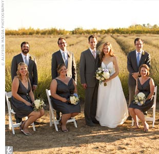 The bridesmaids wore steel-gray V-neck dresses, while the groomsmen matched in dark-gray merino wool suits and Herm&#232;s ties.