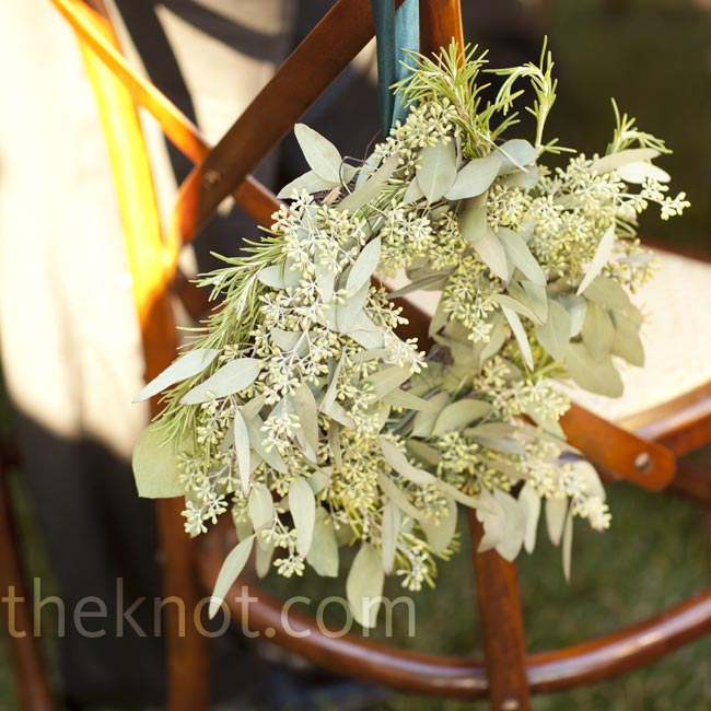 Natural wreaths of seeded eucalyptus, rosemary and lavender hung from the chairs along the aisle.