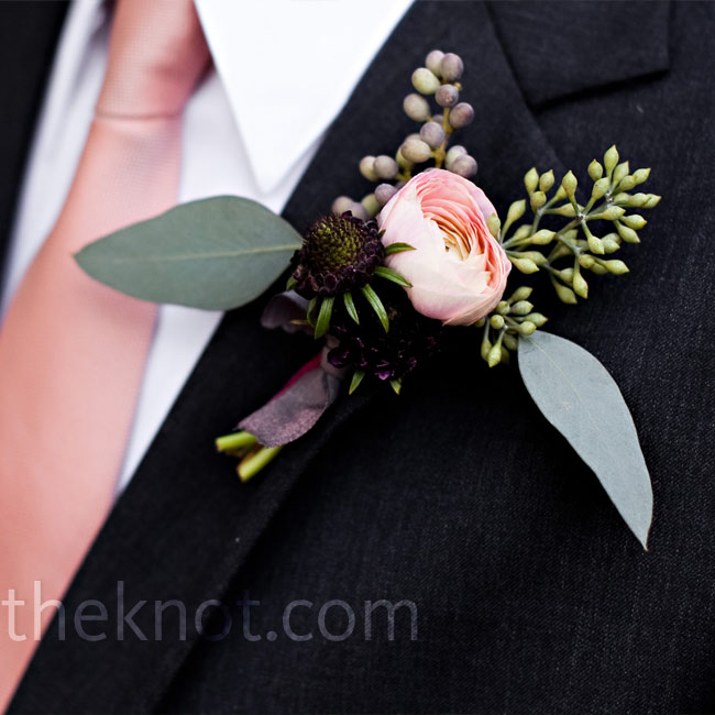 Tim's simple boutonniere of berries and a single pink ranunculus matched his tie.
