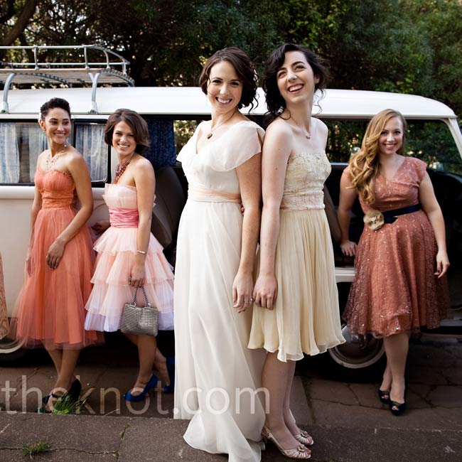 The bridesmaids wore dresses in shades of pink and gold. All except one were vintage.
