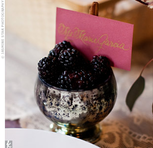The calligraphed place cards were nestled inside small chalices from Anthropologie that were filled with blackberries.