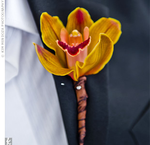 Red wore an orange orchid on his lapel and skipped a tie for a less formal look.