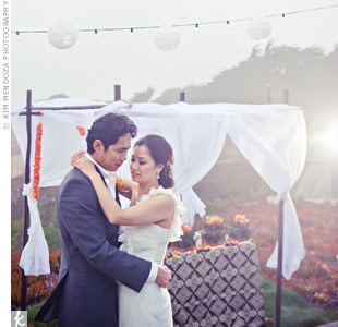 "Larissa and Red danced to ""Forever"" by Dave Hollister beneath romantic hanging lanterns and bulb lights."