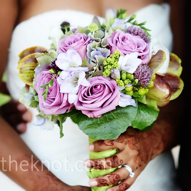 Avrita carried a purple and white mix of orchids, roses, peonies and hydrangeas.