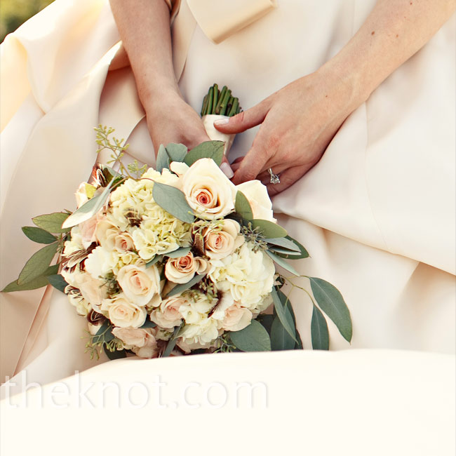 """I wanted a bouquet that would complement the several shades of ivory and champagne in my dress,"" Brittany says. She chose champagne roses, ivory hydrangeas and eucalyptus."