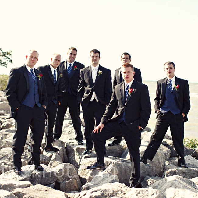Tyler's six groomsmen paired navy vests with their black tuxes to match the bridesmaids.