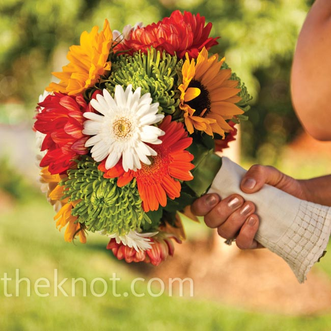 Keeping with the autumn theme, Rachel carried a gorgeous round bouquet of fall-colored sunflowers, spider mums and gerbera daisies.