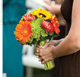 Rachel's bridesmaids carried similar bouquets of orange, green and red autumn blooms.