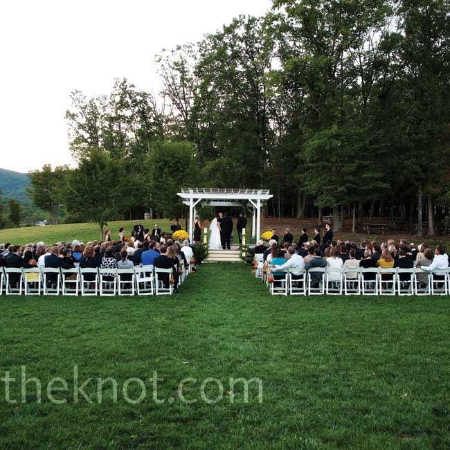 Rachel and Kevin exchanged vows beneath a white gazebo with the Blue Ridge Mountains in the distance.