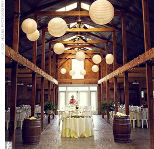 Large, paper lanterns hung from the beams in the stable, which were wrapped in twinkle lights at a lower level, adding just a touch of sparkle to the warm, rustic interior.