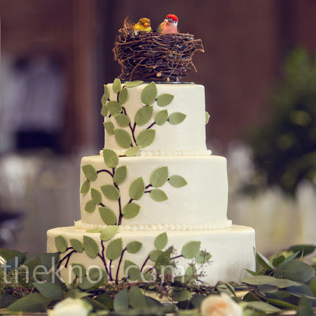 Fondant branches climbed up the vanilla buttercream cake to the third tier, where a little nest with two birds topped off the confection.