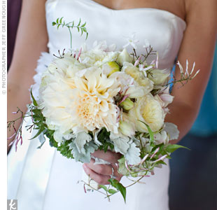 Tina carried an organic-shaped bouquet with full English garden roses, jasmine, café au lait dahlias, blushing bride protea and Dusty Miller.