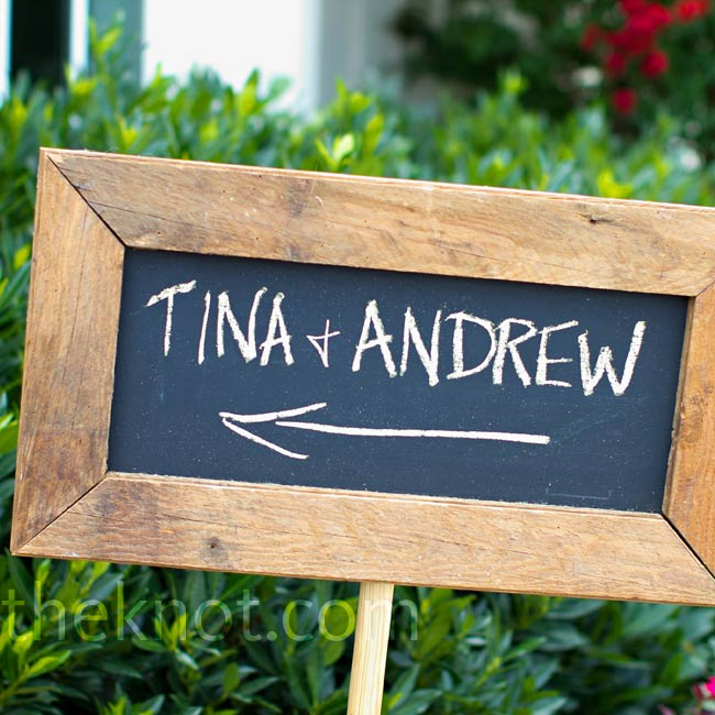 A wooden chalkboard sign guided guests to the Grand Lawn at King Family Vineyards, where Tina and Andrew were to say their vows.