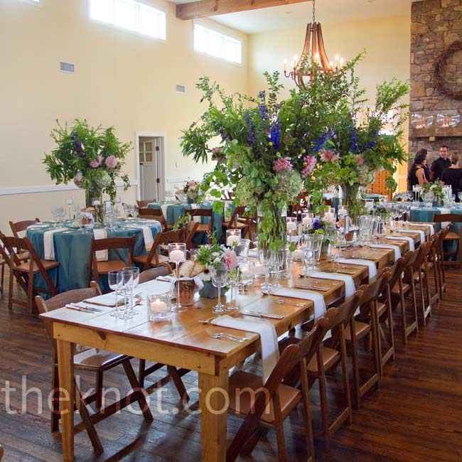 A variety of tall and low-lying centerpieces filled with Annabelle hydrangeas, jasmine and herbs complemented the Carriage House's large scale and natural palette.