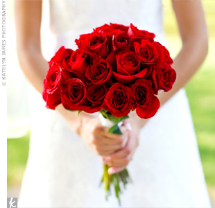 "A lush bouquet of deep red roses was simple, elegant and matched the celebration's color palette. ""I love how the flowers really stood out next to my dress,"" says Holly."