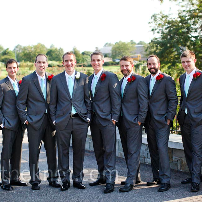 The guys wore classic navy suits to complement their pale-blue shirts and the ties made from extra bridesmaid dress material.