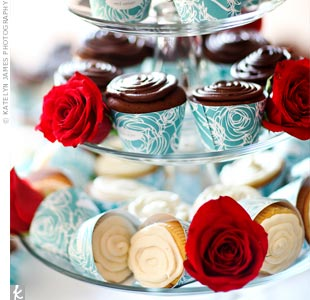 A friend of the couple baked more than 350 cupcakes wrapped in Tiffany blue paper designed by the bride.