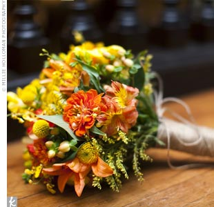 To stay consistent with her wildflower look, Danielle carried a vibrant mix of yellow and orange lilies, orchids, freesia, zinnias and button mums.