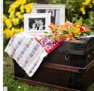An antique trunk sat outside in the ceremony space, and was personalized with retro fabric, framed family photos and a loose gathering of colorful blooms.
