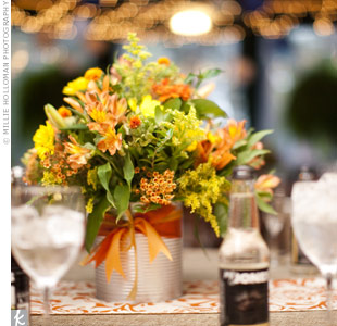 The bride's mother collected several large tomato cans from the pizza place down the street. A coat of silver paint gave them a uniform rustic-feel, perfect for displaying the bright orange and yellow wildflower-style centerpiece arrangements.