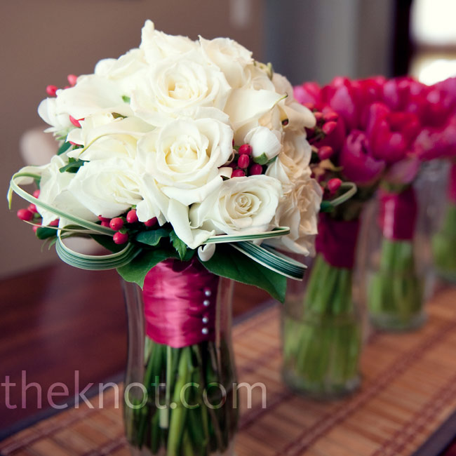 Nadege stood out holding a classic white bouquet of ranunculus and calla lilies with berry accents.