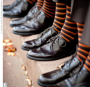 The groom and groomsmen wore matching brown-and-orange-striped socks.