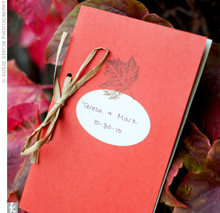These DIY programs were wrapped in a-colored card stock, stamped with a leaf design and tied together with raffia.