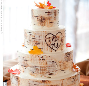 "Designed to resemble a birch tree, the cake had sugar-made leaves and Teresa's and Mark's initials ""carved"" on the side."