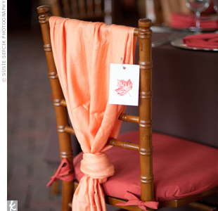 All of the ladies at the wedding found orange pashminas tied to their seats—a fitting favor for the chilly fall evening.