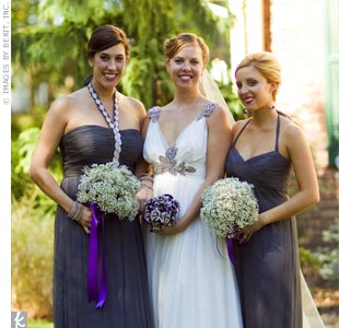 The bridesmaids stood out in two different charcoal-gray dresses by Amsale.