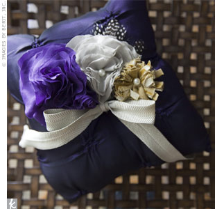 Gray and purple silk blooms and feathers decorated this handmade ring pillow.