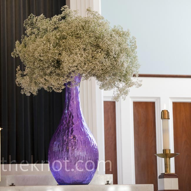 Purple vases filled with baby's breath marked the ceremony altar.