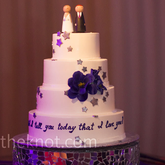 "Silver stars cascaded down the wedding cake to the bottom tier, where ""Did I tell you today that I love you?"" was written in script."
