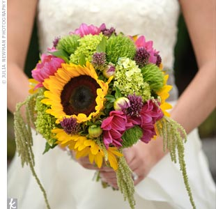 Ashley carried a bursting bouquet of sunflowers (her favorite) with hydrangeas, allium and dahlias.