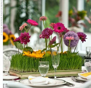 Long-stemmed flowers set into rows of wheatgrass looked as though they were growing right out of the centerpieces.