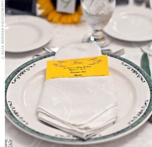 Sunshine-yellow menu cards popped against the white-on-white napkins and china.