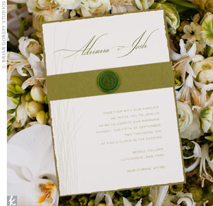 Simple, organic moss-green and off-white invitations set the tone for the day, while an A&amp;J wax seal added a formal touch.