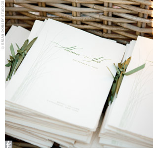 To match the invitations, the programs were printed with the same design and tied together with moss-green ribbon.