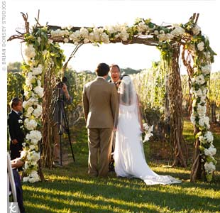 Adriana and Josh were married beneath a textured huppah of branches and curly willows softened with cascading hydrangeas, roses and amaranthus.