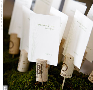 As a nod to the vineyard location, the escort cards were slid into wine corks, which were mounted on toothpicks and set in a bed of moss.