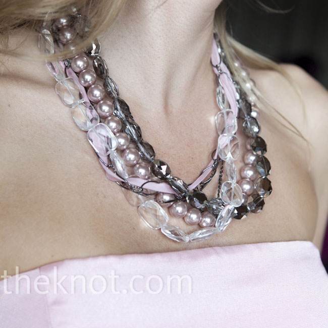 The bridesmaids accessorized with pink and gray necklaces.